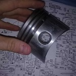 Piston with scoring marks from sanding to fit cylinder